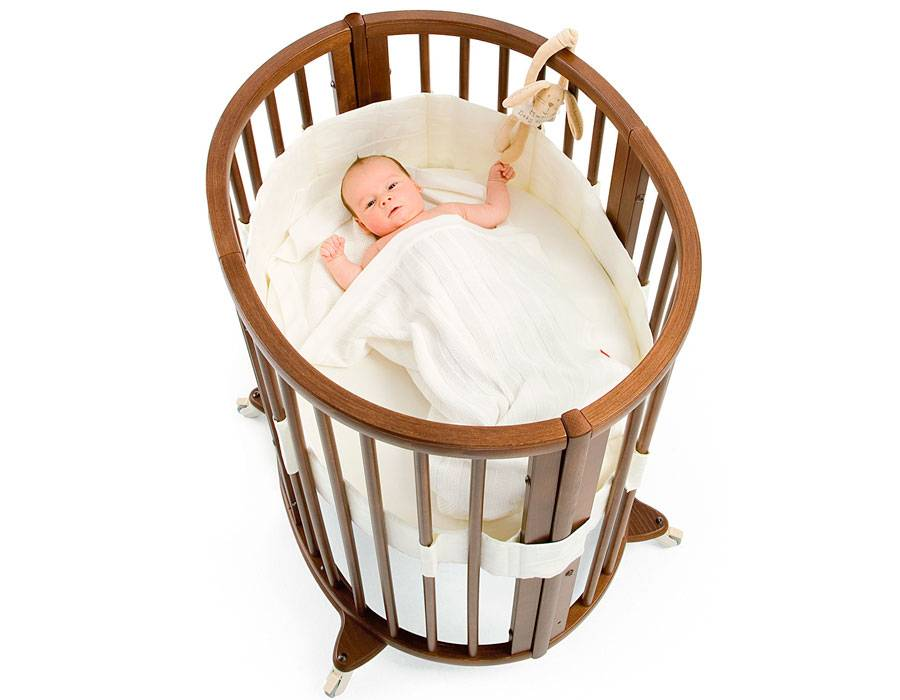 Круглые и овальные кроватки-трансформеры в интерьере детской