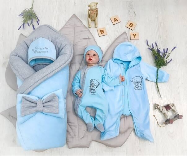 Одеяло на выписку новорожденного из роддома: выбор по сезону
