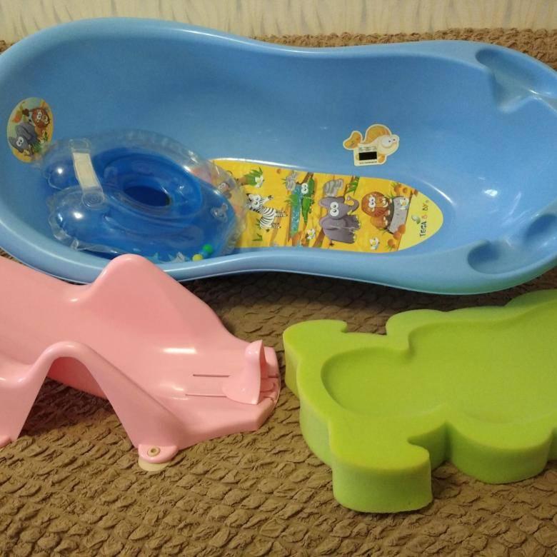 Купание детей в ванной топ-5 девайсов: шапочка, стульчик, горка и гамак для купания, матрас для плавания и надувной круг
