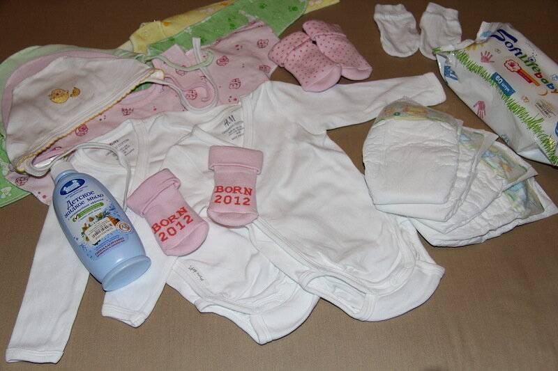 Что положить в сумку для малыша в роддом: список в роддом